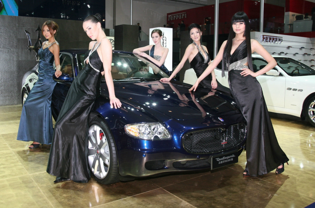 These women are dressed to kill, and the Maserati is dressed to thrill.