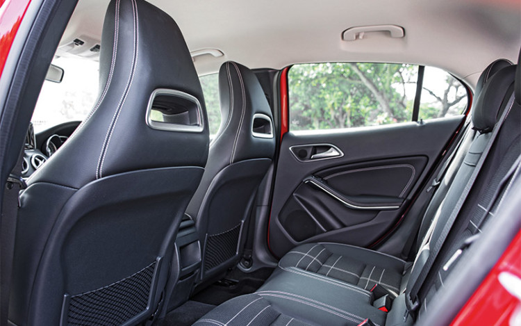 The GLA200's backseat is noticeably more compact than the X1's.