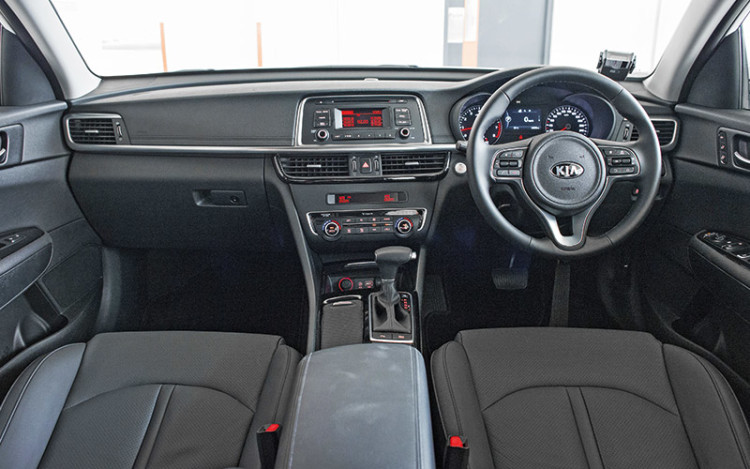 Optima's cockpit offers more amenities than the Sonata's.
