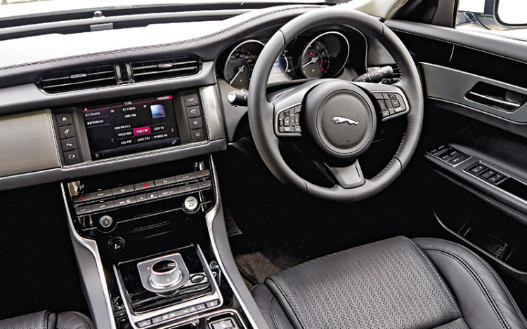 XF's sporty cockpit appeals to execs who are keen drivers.