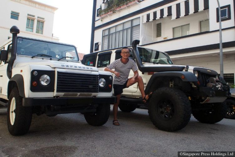 Joe Oh, managing director of an engineering company, and his Jeep Wrangler Unlimited Sport and Land Rover Defender 110.