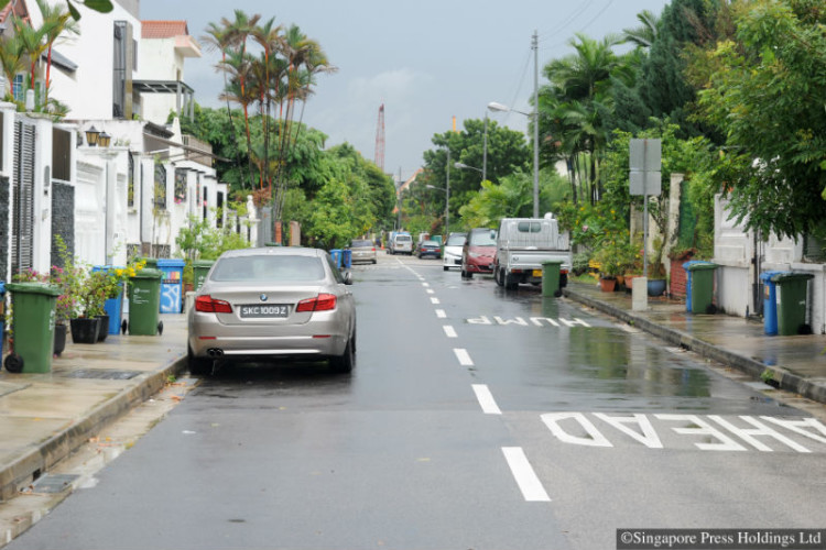 Cars parked on both sides of the two-lane road outside landed homes in a private estate in Sembawang can make navigating the area almost impossible at busy times.