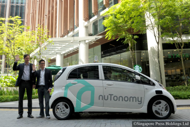 nuTonomy chief Karl Iagnemma (left) and Grab Singapore head Lim Kell Jay with a test car. nuTonomy has been testing driverless vehicles in the one-north area since April 2016 and has tied up with ride-hailing service Grab to let a select group of its customers try them out.