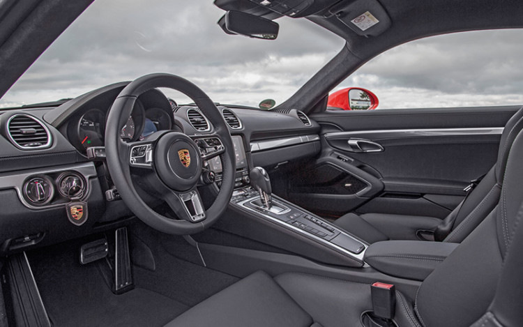 "Cockpit and its options are similar to 718 Boxster's, but with a ""closed"" coupe configuration that comes with a roomier boot."