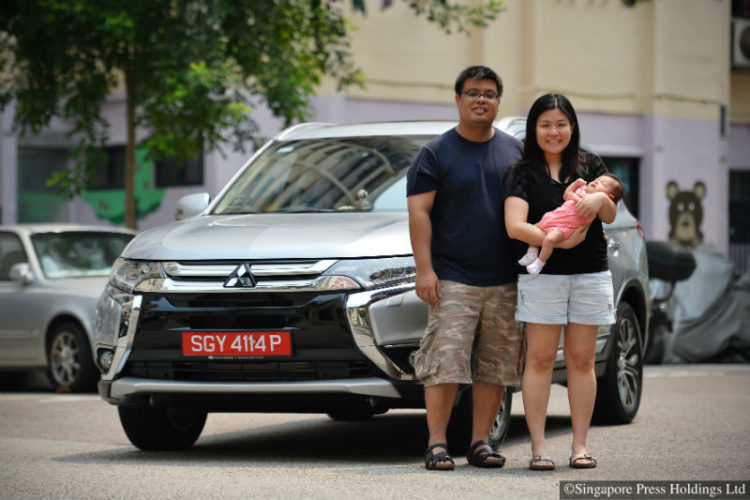 Jeosiah and Clarissa Wee with their child, photographed at Hougang on 11 September 2015. They are among a small but increasing number of car buyers and owners opting for the off-peak car scheme, even as the overall population of these red-plated vehicles on the roads continue to shrink.