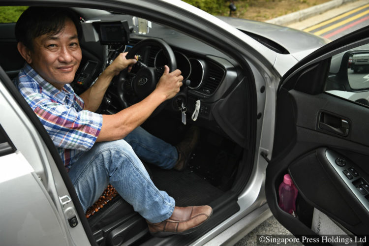 Hong Yong Ming, 50, pictured in his taxi on 5 October, 2016. While he suffered a stroke previously and suffers from some sensory deficit, Mr Hong is still able to drive today, thanks to a special modification in his car that allows him to tap the accelerator with this left foot.