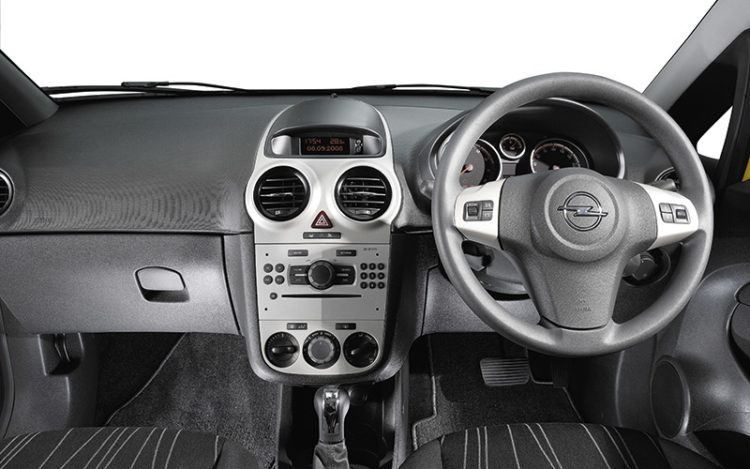 CORSA - Its cockpit has sizeable and supportive seats, but the upholstery seems a bit spartan, and the otherwise good driving position is missing the left footrest available in the other cars. The glovebox is oddly shaped, like the Renault's, but it has integral holders for a cup, cards and pens.