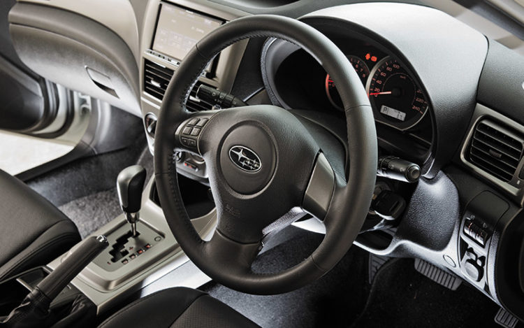 IMPREZA - The cockpit is aesthetically more pleasing than the exterior and provides the clearest views in all directions, especially to the rear. The leather-wrapped steering wheel is the handiest of the group in size, shape and grip. It's well-weighted, too.