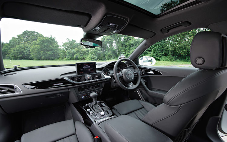 A6 - With its wrap-around windscreen and dashboard angled towards the driver, this aircraft-like cockpit feels the most purposeful. However, rearward visibility is the lowest of the three, while the front passenger seat lacks the memory function available in the other two cars.