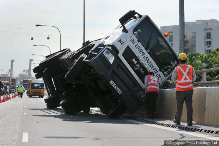 A trailer tipped on its side along West Coast Highway on 3 December 2014.