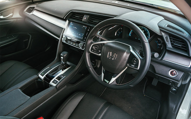 The buttons on the steering wheel are intuitive, and the touch-sensitive volume control works quite well.