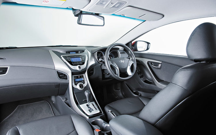 ELANTRA - Most comfortable cockpit of the three, with lower air vents to cool occupants faster and an electrically adjustable driver's seat. Reversing camera's video display could be clearer, though.