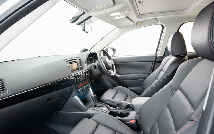CX-5 - Comparatively small cockpit is also less practical than its rivals', but ideal for long journeys thanks to it having the widest footrest and an electrically adjustable driver's seat. Standard sunroof gives this space a more upmarket feel, too.