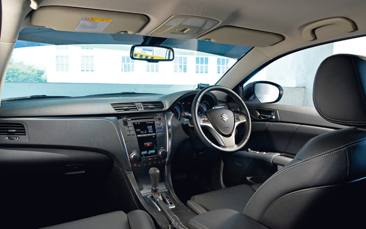 KIZASHI - Smaller than the rest in terms of cabin space, but driver's seat is the most supportive, making it ideal for long drives. Suzuki's sporty disposition is reflected in the conventional handbrake, in contrast to the others' foot-operated parking brake.