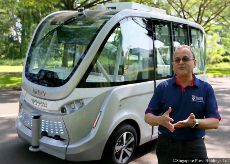 Professor Subodh Mhaisalkar, executive director of Energy Research Institute at NTU (ERI@N), with Arma, a driverless, air-conditioned shuttle that can carry up to 15 passengers. The Arma shuttle will be rolled out to the roads as part of a pilot test for self-driving buses in Singapore. It will ply between CleanTech Park and the Nanyang Technological University (NTU) campus over a 1.5km route.