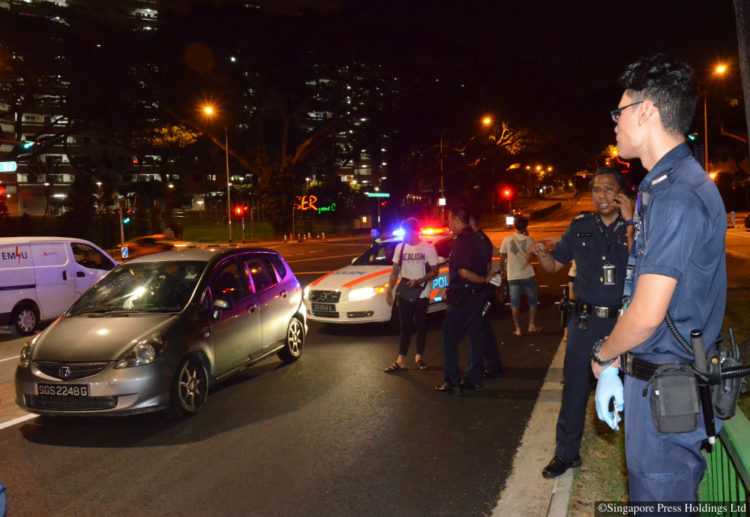 The scene of the incident at Telok Blangah Crescent on 13 January 2017. A bizarre car chase ended with the arrest of a driver and his passenger for drug offences; it turned out to be a rental car recovery operation gone wrong.