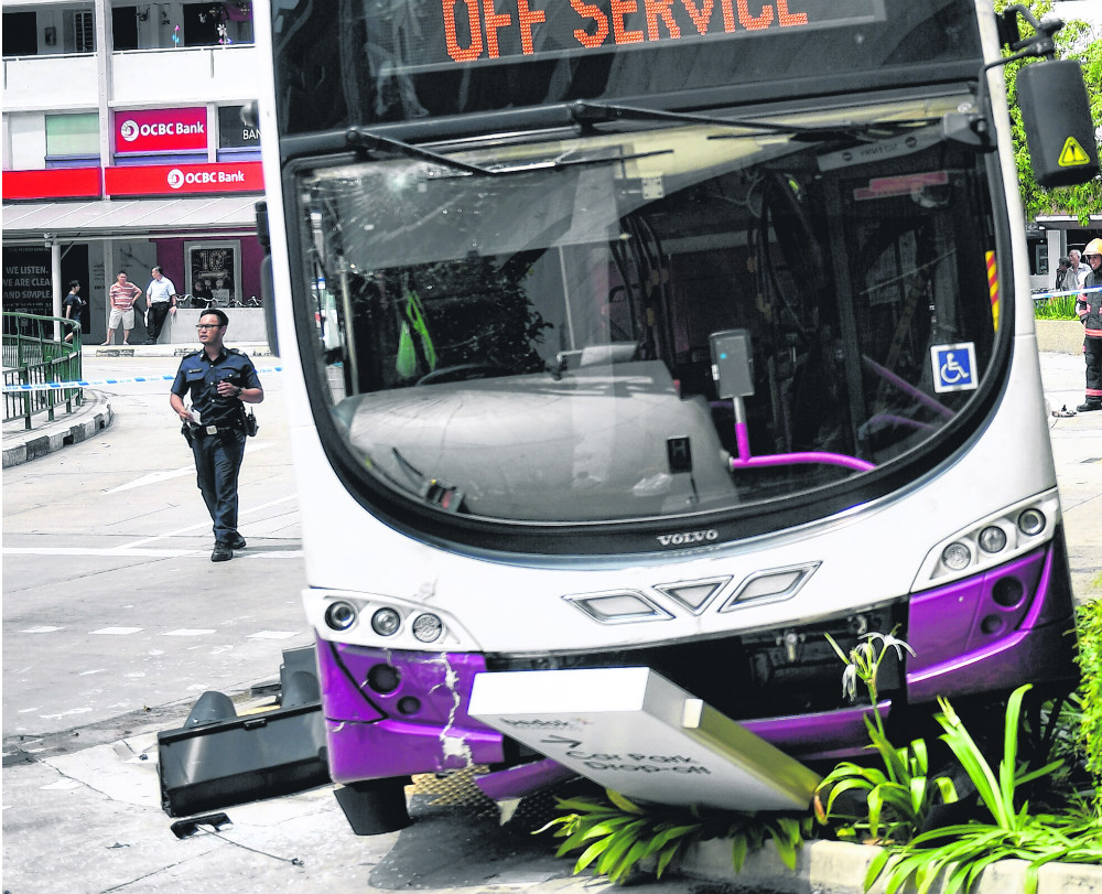 Woman trapped under double-decker bus in accident in Bedok
