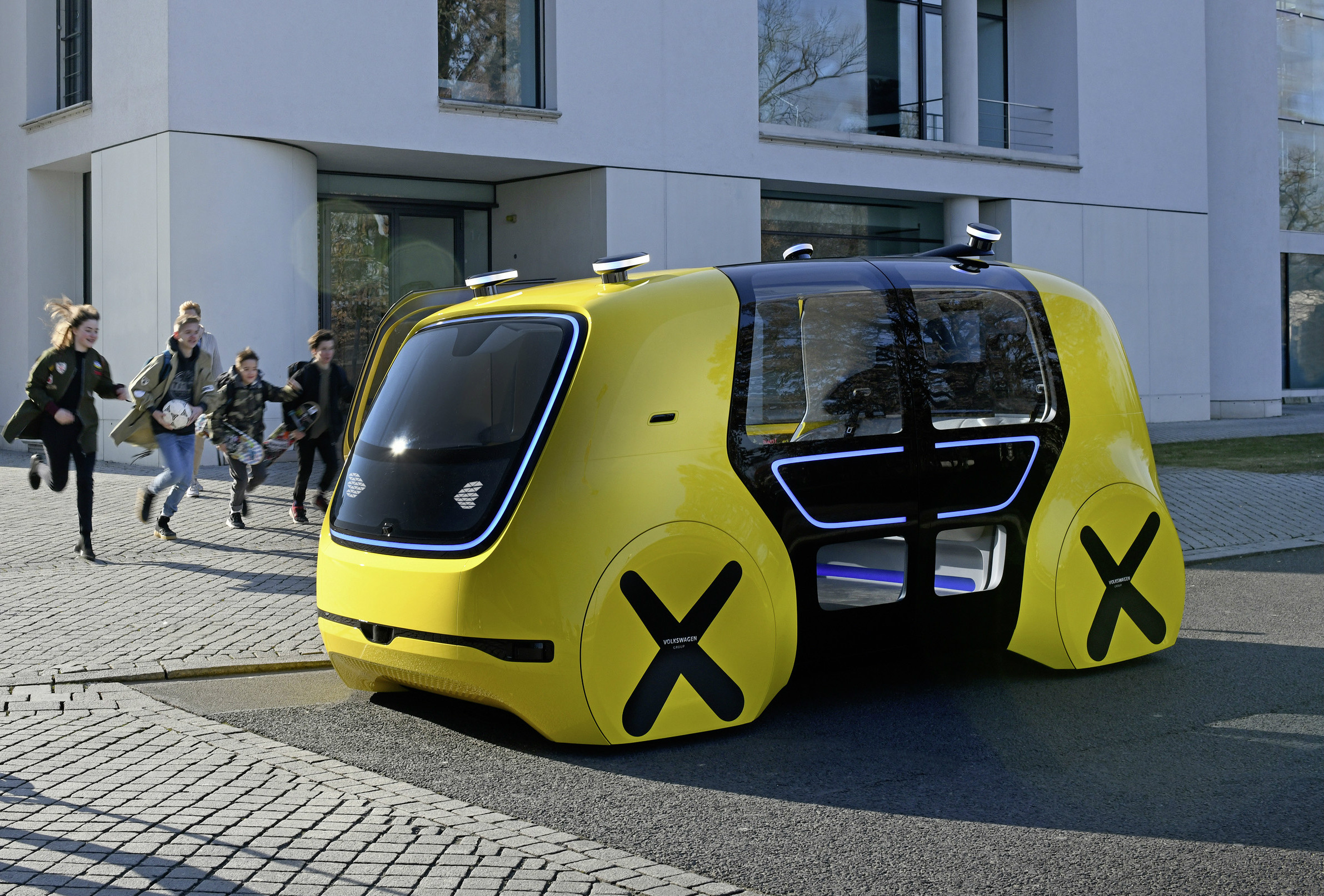 Two of the world's biggest automakers are thinking, and riding, outside the box with their latest driverless vehicle concepts.