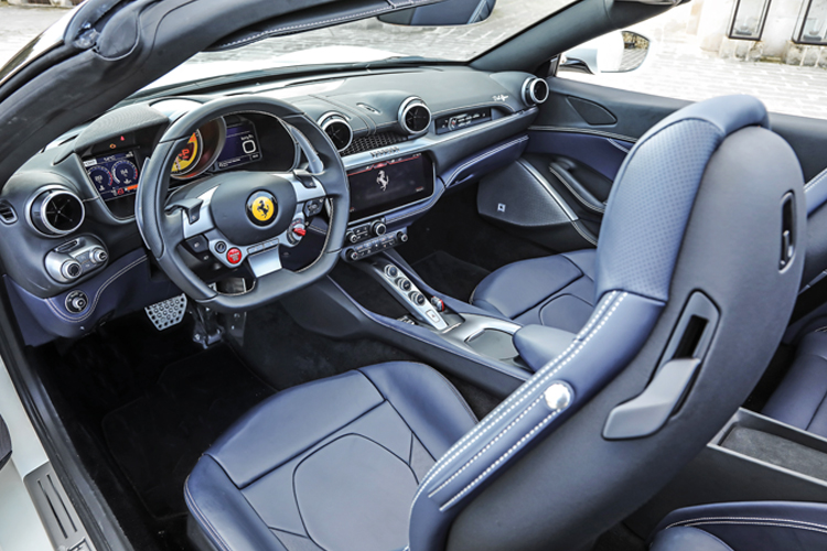 Ferrari Portofino's cockpit is similar to the Ferrari GTC4Lusso T's, with a desirable mix of technology, luxury and sportiness.