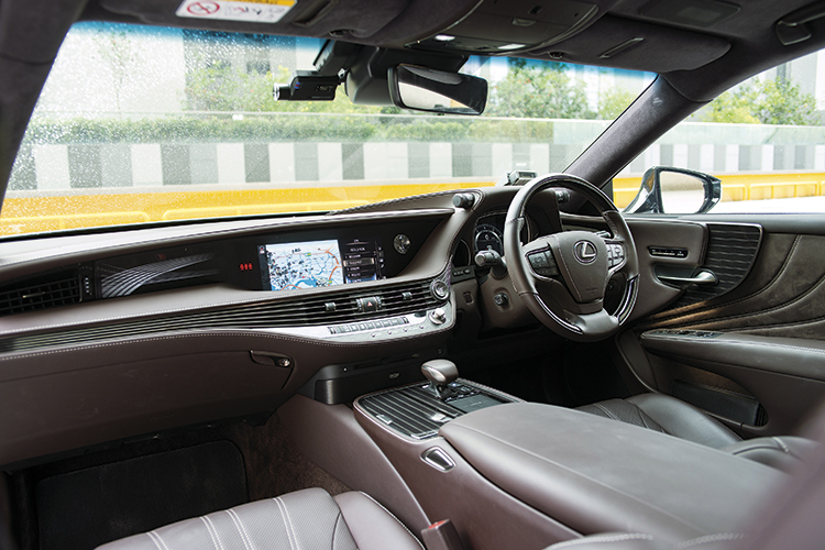 Lexus LS350's cockpit is solid and refined.