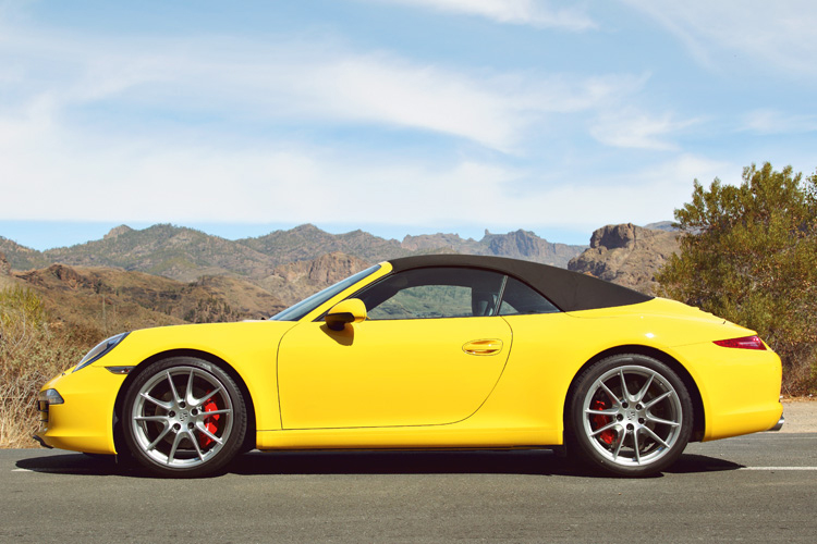 "Innovative ""panel bow"" canopy retains the distinctive 911 roofline while providing coupe-like comfort and headroom underneath."