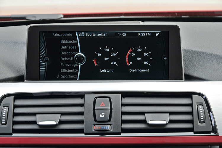 Dash-top display shows real-time power and torque when driving in Sport mode.