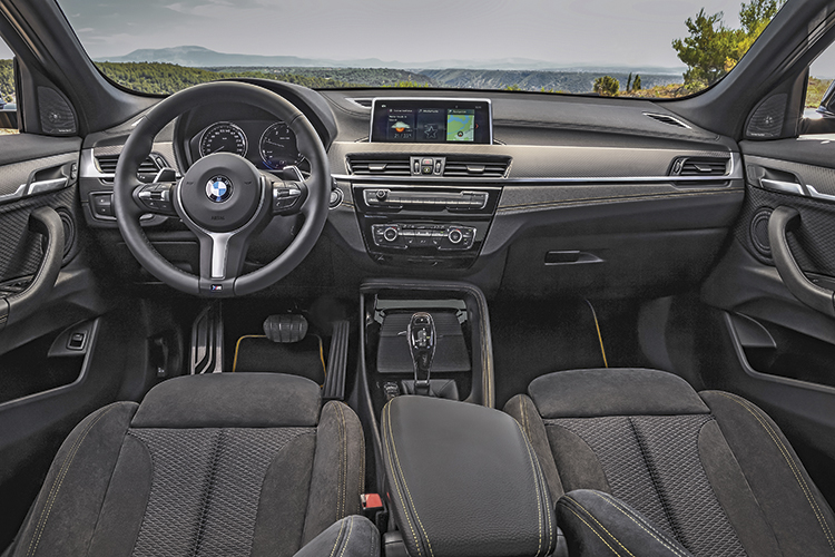 BMW X2's cabin is laid out like the BMW X1, but looks sportier, with decent headroom despite the low roofline.