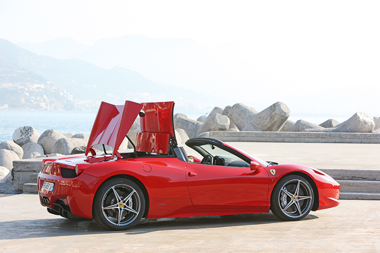 It takes 14 seconds to deploy or retract the roof, but the 458 must be at a standstill.