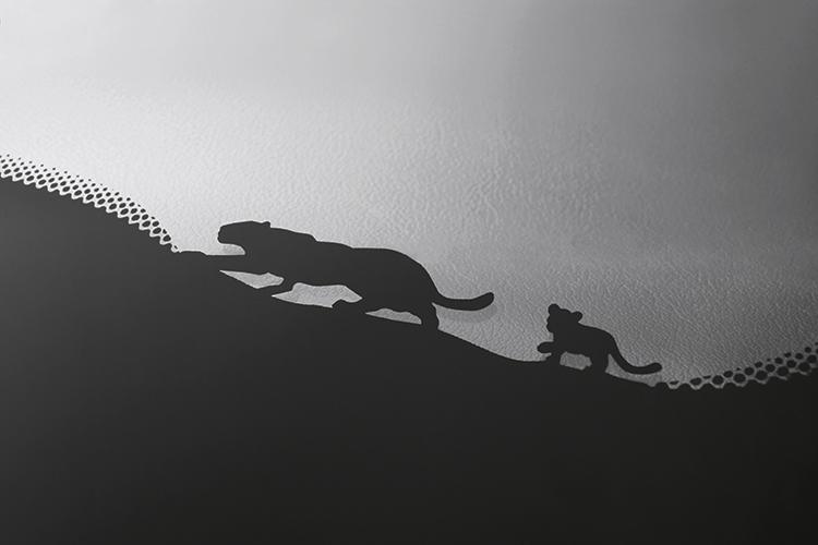 The Jaguar E-Pace's windscreen has a cheeky motif of a cub playfully following an adult jaguar.