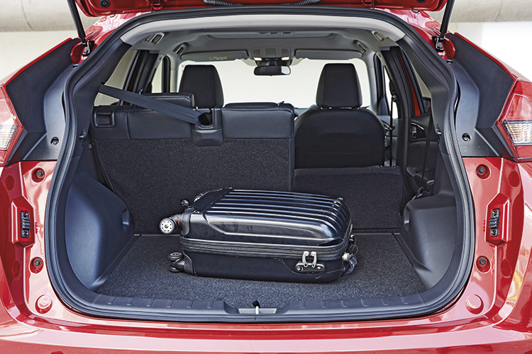 The Mitsubishi Eclipse Cross' 448-litre boot (rear seats up) would've been even more useful if not the substantial wheel arch intrusions.
