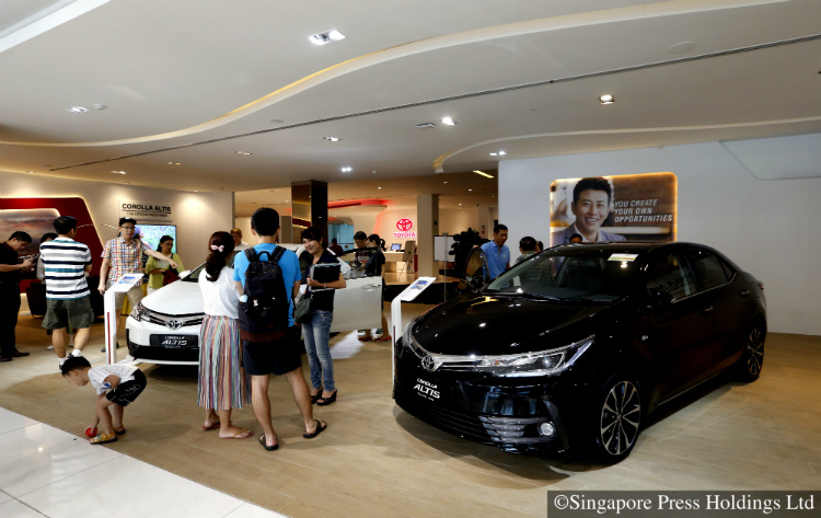 cat a coe price drop sends buyers back to singapore car showrooms