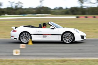Learn how to drive confidently in fast sports cars at Mount Cotton's Porsche Sport Driving School in Brisbane, Australia.