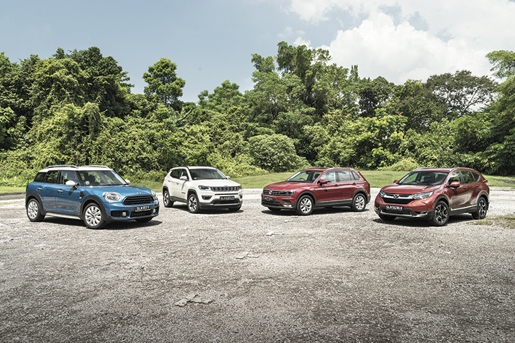 Mini countryman vs jeep compass vs vw tiguan vs honda cr v for Jeep compass vs honda crv