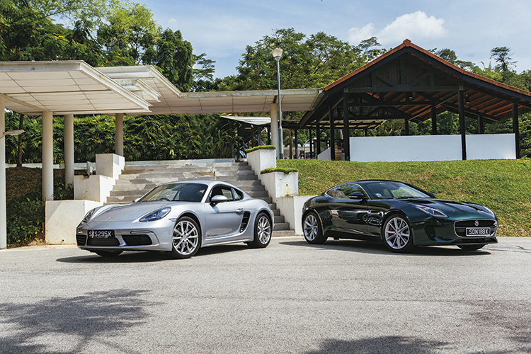 porsche 718 cayman and jaguar f-type front static