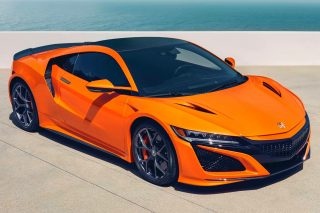 The dynamic handling performance of the Honda NSX has been improved by chassis upgrades, new-specification tyres and tuning of the Sport Hybrid power unit, while the addition of new Thermal Orange Pearlescent paint is part of the Japanese supercar's exterior design refresh.