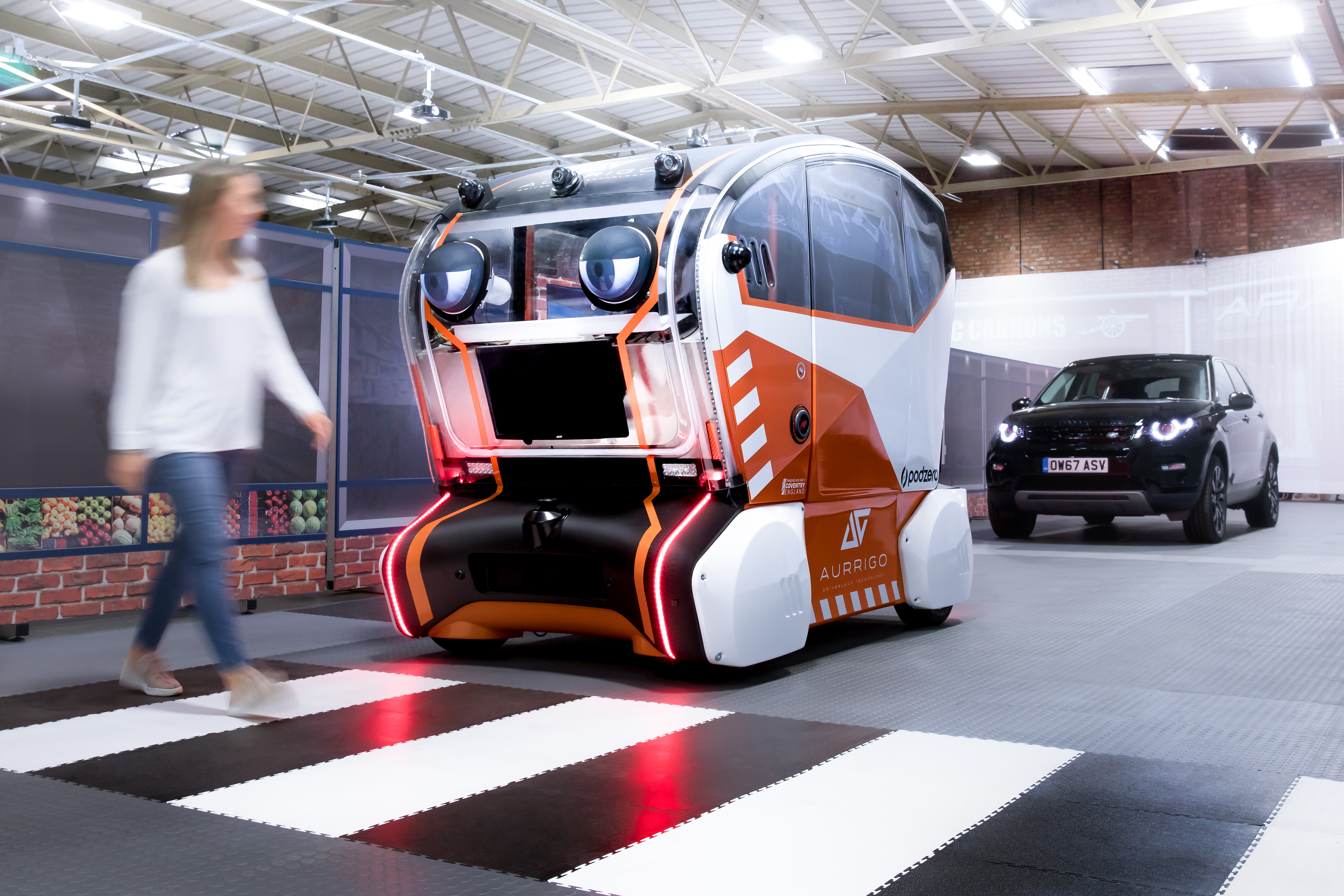 """The intelligent self-driving pods have large """"virtual eyes"""" to interact with other road users, making """"eye contact"""" with pedestrians to signal intent, and these are part of engineers' work with psychologists to understand human trust in autonomous vehicles."""