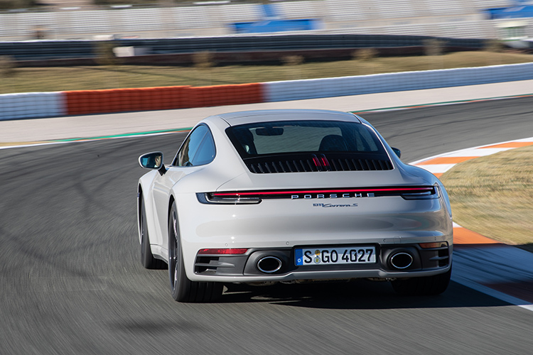 porsche 911 carrera s driving rear