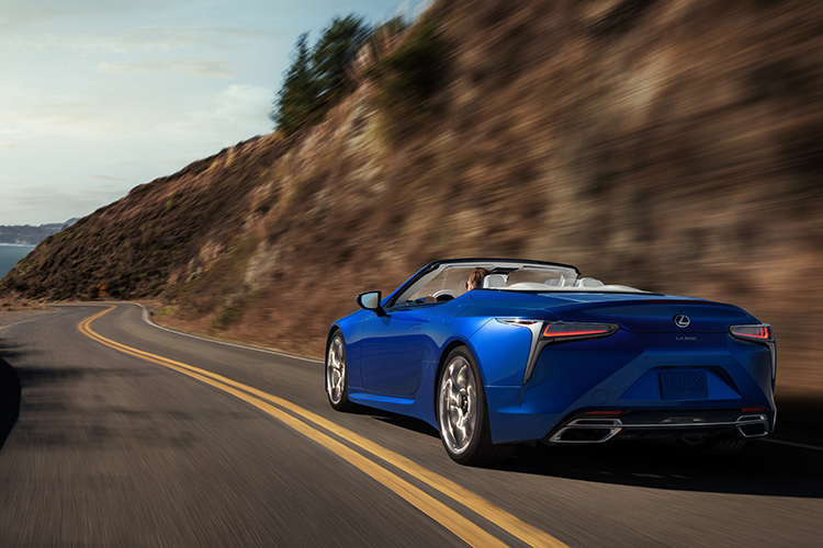 lexus lc500 convertible driving rear