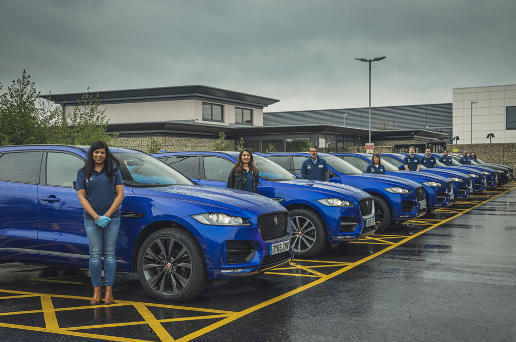Jaguar Land Rover staff and cars