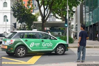 grab to stop passengers from sitting beside drivers